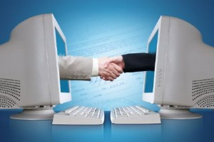 Computers shaking hands